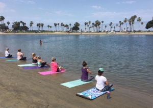 yoga on bay water toes mat